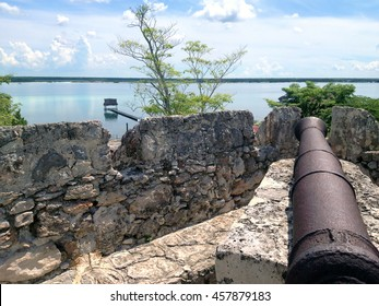 Ancient cannon on the wall of the fort of San Felipe in Bacalar Lagoon, Mexico