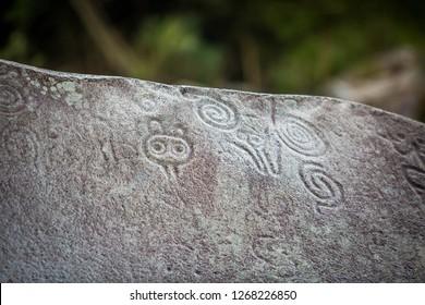 Ancient carved figures Piedra Escrita in Jayuya Puerto Rico