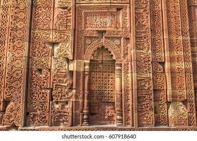Ancient carved red sandstone background at the Qutb Minar medieval monuments.