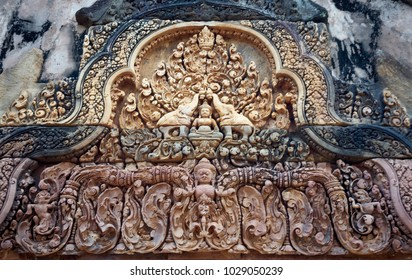 """Ancient carved stone pediment, Banteay Srey (Srei), """"citadel of the women"""", """"citadel of beauty"""",10th-century temple dedicated to Hindu god Shiva, known as a """"precious gem"""", or the """"jewel of Khmer art"""""""