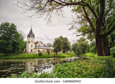 Ancient castle. Palace among green trees by the lake in summer. Palace among green trees by the lake in summer. Podkarpackie voivodeship.