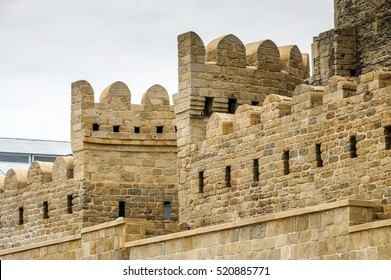 Ancient castle palace in Baku. Castle wall and tower gate. Antique fort window and walls isolated. Old castle palace fort landscape. Medieval architecture build of stone bricks in the city center Baku