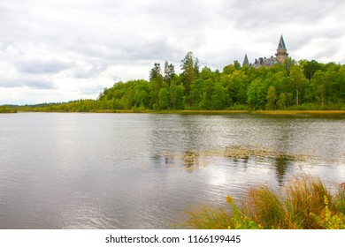 The ancient castle Teleborg during a cloudy summer day in Smaland in Sweden is located in Vaxjo by the lake.