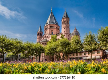 Ancient cathedral in Meinz, Germany surrounded by spring flowers