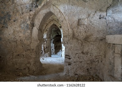 Ancient cave of sandstone abandoned and excavated in the mountain with rooms and decorations in the form of an old Gothic cathedral