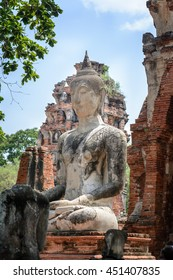 Ancient cement buddha statue on ruined ancient temple