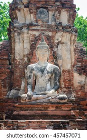 Ancient cement buddha statue at ruined ancient temple in world heritage city of Ayutthaya, Thailand
