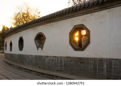 Ancient Chinese architecture features, white walls and decorations.
