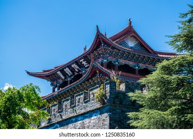 Ancient Chinese architecture turret building in Dali Old Town at sunny day, Yunnan Province, China. The translation for the non-English words is Dali Old Town and Wuhua building.