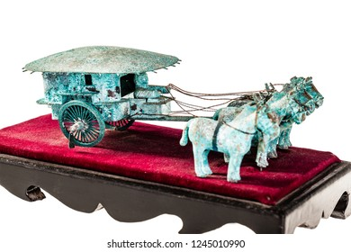 an ancient chinese chariot reproduction isolated over a white background