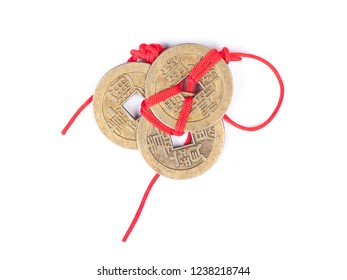 """Ancient Chinese coins connected by red thread symbol of fortune, Ornament of china new year festival isolated on white background (translate of text on coins means """"Shun rule through treasure"""")"""