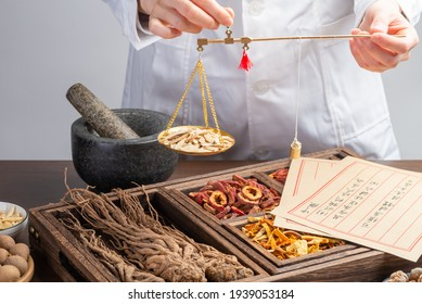 Ancient Chinese medicine books and herbs on the table.English Translation:Traditional Chinese medicine is used in the prevention and treatment of diseases, has the function of rehabilitation.