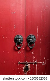 Ancient Chinese Red Gate, traditional lion knocker, locked gate.