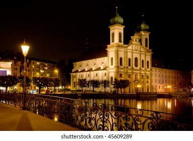 Ancient christian cathedral in Luzerne, Switzerland at night. View from a bridge