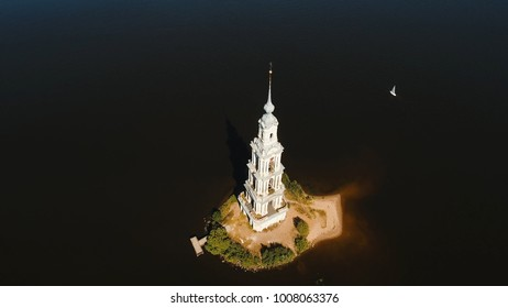 Ancient Christian church located on an island in the middle of the lake. Aerial view Old monastery.