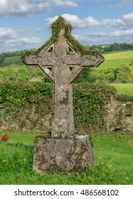 Ancient Christian cross headstone in a graveyard in Ireland.