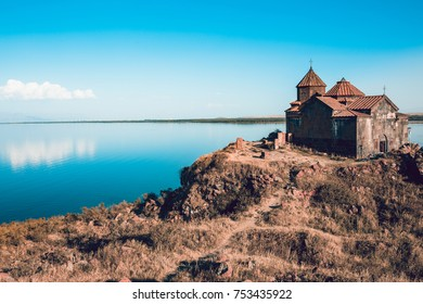 Ancient church in Armenia. Hayravank Monastery on the shore of lake Sevan. Travel destination. Concept of travel and exploration.