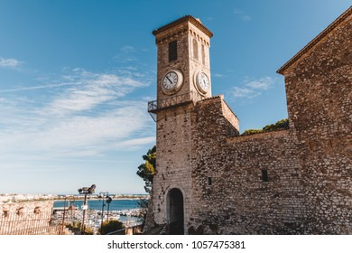 ancient church with clock tower at old european city, Cannes, France