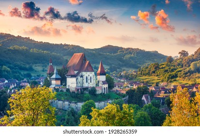 Сharm of the ancient cities of Europe. Spectacular summer view of fortified Church of Biertan, UNESCO World Heritage Sites since 1993. Landscape of Biertan town, Transylvania, Romania.