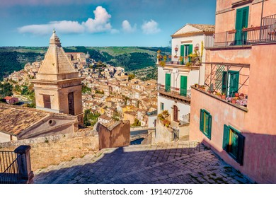 Сharm of the ancient cities of Europe. Sunny spring cityscape of Ragusa town with Church of St Mary of the Stairs on background. Wonderfulmorning scene of Sicily, Italy, Europe.  - Shutterstock ID 1914072706