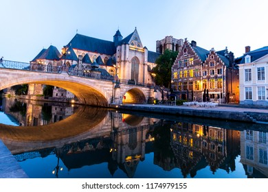 Ancient City center of Gent in Belgium during evening with lots of illuminated buildings
