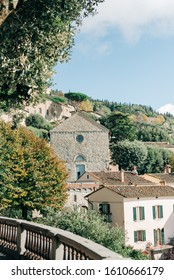 The ancient city of Cortona in Italy, in Tuscany. Tuscany medieval churches on green background of italian nature