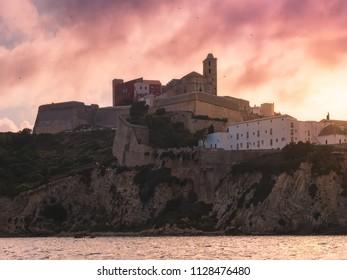 Ancient city of Dalt Vila, Ibiza, Spain, at sunset.
