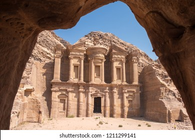 Ancient city of Jordan, Petra, Monastery under a blue sky on a sunny day in the frame of small cave