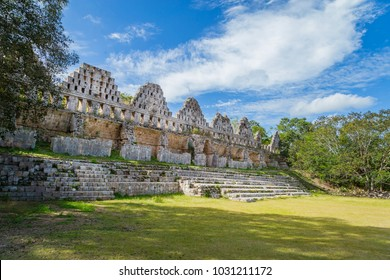 Ancient city in the jungle. Mayan temple Uxmal archeological site, ruins in Yucatan. Pyramid of the Magician (Piramide del adivino) in ancient Mayan city Uxmal, Mexico