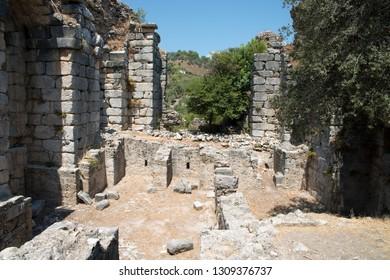 Ancient city of Kaunos, Dalyan valley, Turkey. Kaunos (Latin: Caunus) was a city of ancient Caria and in Anatolia, a few km west of the modern town of Dalyan, Muğla Province, Turkey.