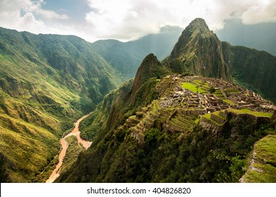 The ancient city of Machu Picchu, Peru. Overlooking ruins on the Inca citadel in the Andes Mountains and the river valley below