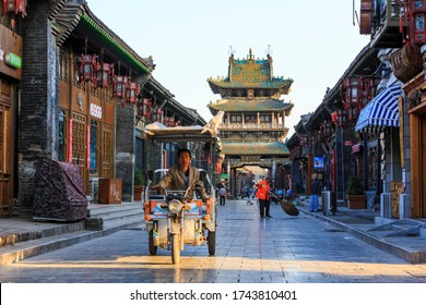 Ancient City of Ping Yao in the morning,People always travel by motorcycle: August 27 2016-Ping Yao is a UNESCO World Heritage site and popular place to travel.Ping Yao, Shanxi, China.-Image