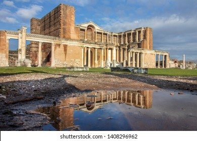 Ancient city of Sardes. The ruins of Sard. The remaining structure from the present to the present. Reflection of the historical building into the water. Sardis, Manisa, Turkey
