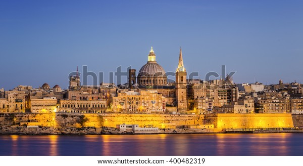The ancient city of Valletta at blue hour with St.Paul's Cathedral - Malta