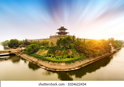 Ancient city walls in Xi'an, China, landscape at dusk.