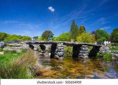 The ancient clapper bridge at Postbridges in Dartmoor National Park, Devon England UK