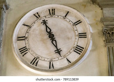 ancient clock on marble wall
