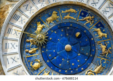 Ancient clock Torre dell'Orologio in San Marco Square, Venice, Italy. Detail with Zodiac signs. Historical landmark and travel attraction of Venice. Astrological vintage clock in Venice close-up.