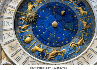 Ancient clock Torre dell'Orologio in St Mark's Square in Venice. Detail with clock face and astrological Zodiac signs. Medieval art of Italy. Astrology concept.