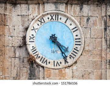 Ancient clock tower of central Saint Nicholas Church, Perast town, Montenegro