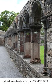 Ancient cloister with stone columns, walk clockwise, Jerpoint Abbey, Ireland.