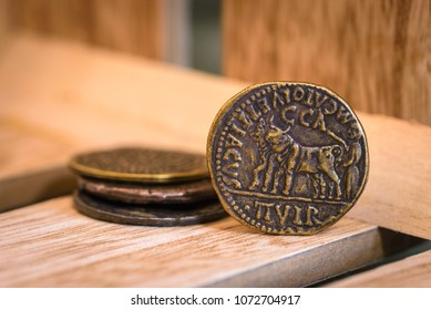 Ancient coins on a wooden box