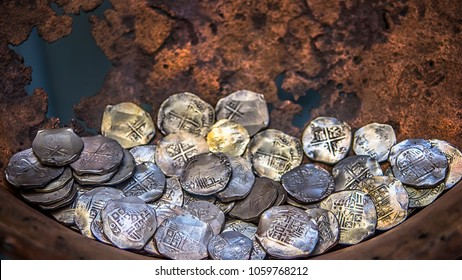 Ancient coins, a treasure found in a copper basin. Museum of Archeology of Moscow.