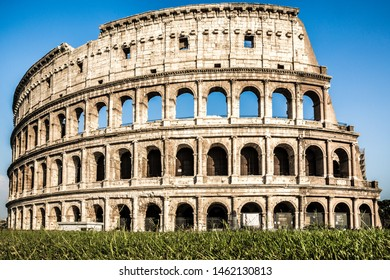 The ancient Colosseum, also know as Flavian Amphitheatre or Colosseo, an oval amphitheatre east of the Roman Forum with a clear blue sky in the historical city of Rome, Italy, Europe