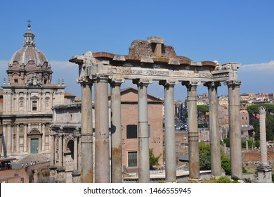 Ancient columns with antique buildings in Rome