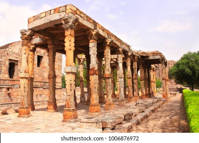 Ancient columns with stone carving in Quwwat-Ul-Islam mosque, Qutub Minar complex, New Delhi, India.  UNESCO World Heritage site