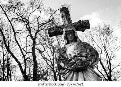 Ancient concrete statue of Virgin Mary at Rasos cemetery in Vilnius, Lithuania. Black and white image