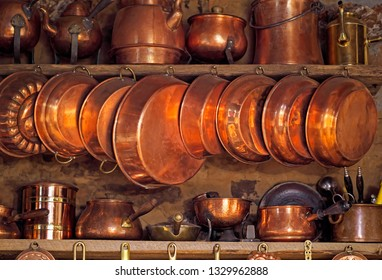 Ancient cookware in rural kitchen as decoration or aesthetic and nostalgic link to past.