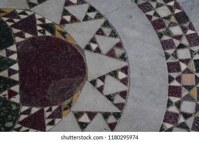Ancient cosmatesca paving in a Romanesque church