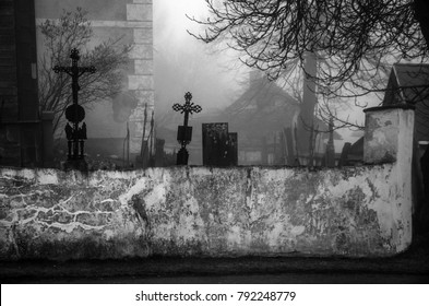 Ancient creepy graveyard in the fog